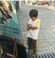 Little boy in Guatemala writing JW.ORG on his little arm to later watch more Sofia and Caleb videos....