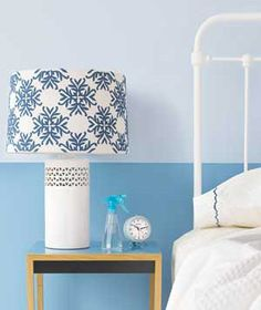 Incorporate Prints on Accent Pieces  But prints aren't reserved for the bedcovers. They're just as arresting when set on a modern-shaped lampshade.