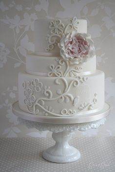 white wedding cake with beautiful detail by anita