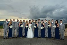 Navy Blue and Grey Winter Wedding Color Inspiration: White bride gown, navy bridesmaid dresses with silver grey scarfs, navy groom suit and grey groomsmen suit, grey table linens and navy napkins… Navy Blue Bridesmaid Dresses, Wedding Bridesmaid Dresses, Wedding Attire, Costume Garçon, Costume Gris, Costumes, Gray Groomsmen Suits, Bridesmaids And Groomsmen, Grey Suits