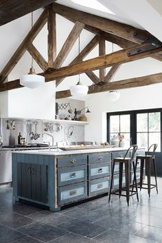 Interior architect Paula Barnes has extended this nineteenth-century London rectory and made creative use of reclaimed materials and antique-fair finds to create a comfortable family house. Paula commissioned the Sussex-based kitchen makers Reece Lewery and John Mildoon to create the 2.7-metre island unit from reclaimed floorboards.