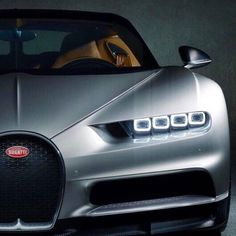 The#BugattiChironis amid-engined two-seated #sportscar designed and developed by the#Bugattiautomotive group (which is owned by the#Volkswagen Group) as the successor to the #BugattiVeyron.The Chiron was first revealed at the#GenevaMotor Showon March 1 2016.  The car is named in honor of the Monegasquedriver#LouisChiron.  The main carryover piece will be the 8litreW16quad-#turbochargedengine though it is heavily updated. Direct injection will be added and two of the four turbos will be…