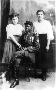 """Colonial soldier with German women, 1919. In the period following World War I, French colonial troops were used as part of the Allied occupation of the German Rhineland, in accordance with the Treaty of Versailles.Hitler wrote about the Black Shame in Mein Kampf, decrying the """"negrification"""" of Europe. His government would later sterilize 500 or so mixed-race children born of African servicemen and German women (the so-called """"Rhineland Bastards"""""""