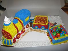 3D Train Cake - I used the 3D Train Cake by Wilton and the 2 box cars I baked a cake in a loaf pan and halfed it. I used colored licorice, kit kats, m&m's,etc to add accent.