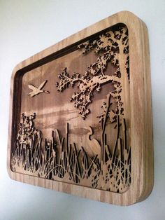 Create a layered wooden piece of art from your own photographs. Click the link below for instructions.