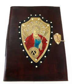 Large archangel Michael shield leather hand bound by skrocki. The back of the book has a hand carved dragon.