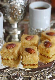 Arabian dessert with semolina, almonds and rosewater syrup.(via pinterest)