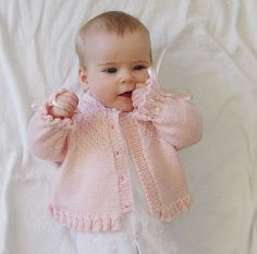 Baby girls sweater with detailed bodice and frilled hemline and cuffs Knitting pattern by OGE Knitwear DesignsThis pretty little girls jacket/sweater has beautiful detail on the bodice and a frilly cuff on the sleeves and hemline. Would also look bea Baby Sweater Patterns, Baby Clothes Patterns, Baby Patterns, Clothing Patterns, Little Girls Jackets, Baby Girl Jackets, Baby Pullover Muster, Sirdar Knitting Patterns, Baby Girl Sweaters