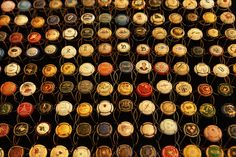 """REIMS, FRANCE: The caps of opened French Champagne have become a hit with collectors and are on display in this photo taken at a wine flea market in the """"capital"""" of the Champagne region. Best Champagne, Champagne Taste, Best Wine Clubs, Champagne Region, Wine Packaging, Bottle Top, Sparkling Wine, Wine Drinks, Plugs"""