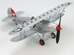 Hobbymaster 1:48 Hawker Fury Diecast Model Airplane HA8004 This Hawker Fury MkI K5674 (RAF 43 Sqn 1930) Diecast Model Airplane features working propeller. It is made by Hobbymaster and is 1:48 scale (approx. 15cm / 5.9in wingspan).  General Background  The first flight of the Hawker Fury I took place in March 1931. Because of the Great Depression and the high cost of the Fury only 118 were produced for the RAF. It was the first RAF operational aircraft to exceed 200 mph in level flight. In…