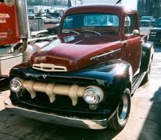 Own an old red Ford truck