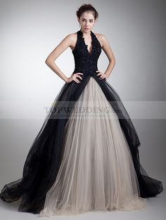 Two toned halter tulle Quinceanera Dress with beaded applique: The fully beaded and appliqued bodice looks much dazzling and alluring in this ball gown. Two toned tulle skirt spare no efforts in presenting a fabulous look.
