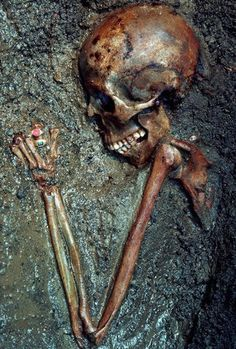 August 1982, Herculaneum, Italy --- Jeweled gold rings still encircle the finger of a partially excavated skeleton at Herculaneum (Ercolano), Italy. Herculaneum, like its neighbor city Pompeii, was buried by material from the sudden eruption of Vesuvius in A.D. 79