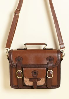 Cottage Visit Bag in Cinnamon. Packed with a good read and all the other necessities, this faux-leather satchel accompanies you on a day trip away from it all. #brown #modcloth