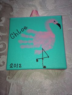 Kid's handprint art--flamingo.  On 6x6 canvas.