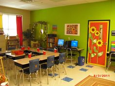 A splash of green and a sunflower theme welcomes students to this 5th grade classroom.