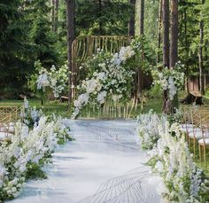 Having a wedding ceremony in the woods itself is magical, yet the additional white flower arrangement adds in a feminine end note. Share your thoughts below! Mint Wedding Decor, Wedding Ceremony Decorations, Aisle Flowers, Wedding Flowers, Wedding Stage, Dream Wedding, Church Wedding, Wedding Photography Props, White Flower Arrangements