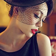 Birdcage veil and red lip. Vintage Glam.