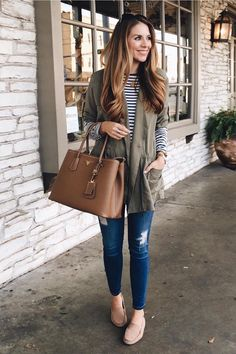 Ashley Robertson keeps her look casual in a black and white striped long sleeve shirt and distressed skinny jeans. She adds our olive green drawstring jacket for and extra layer of warmth and style to complete her outfit | Banana Republic