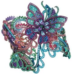 Bracelet manchette en titane serti de spinelles, de tourmalines Paraïba, de tsavorites, d'améthystes, de rubis, d'émeraudes et de topazes. Les papillons peuvent être démontés en broche et en boucles d'oreilles. Réf. : 859760-9001
