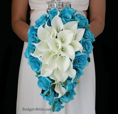 Turquoise and White Wedding Flowers.  Calla lilies with Malibu roses around in a teardrop bouquets.  Packages starting as low as $100