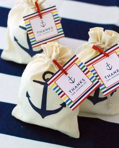 """The rich, nostalgic tradition of seafaring is captured in a simple, muslin favor bag, perfect for seaside and shipboard events. Pack this mini duffel full of sweets for your guests' journey home. Features and facts:    Natural muslin favor bag with a drawstring closure and stamped with a deep-blue anchor  Favor bag measures 6"""" h x 3 ¾"""" w  #http://timelesstreasure.theaspenshops.com/voyages-anchor-muslin-favor-bag.html"""