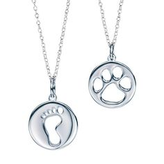 """Celebrate life and love! Paw print cutout and baby footprint cutout: 1/2"""" diam. medallions on a 19"""" L sterling silver chain.Footprint, Paw Print"""