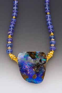 Australian boulder opal, faceted tanzanite and 18K gold