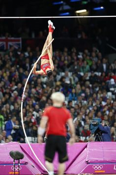 London 2012 - The flex of the pole provides the energy to fling Jennifer Suhr up and over gold medal heights in the women's pole vault.  IOC/Jason Evans