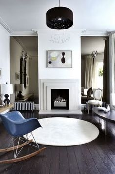 Contemporary Edwardian Interior. Great use of mirrors adjacent to chimney.