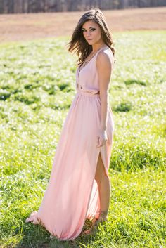 """""""Talks To Angels Maxi Dress, Rose Quartz""""    This maxi is purely angelic! The soft rose quartz color paired with the flowing of this maxi dress is magical! But what really has us in awe is the back! That open strappy back is simply stunning!!"""