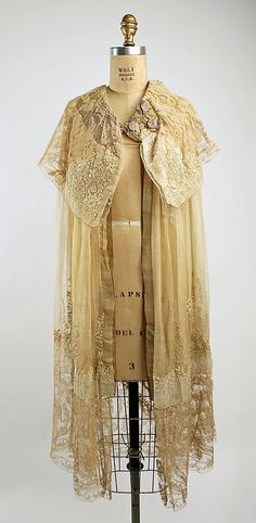 French evening ensemble, Boué Soeurs  (French) in cotton, silk, metallic. Dimensions: Length at CB (a): 50 1/4 in. (127.6 cm) Length at CB (b): 44 in. (111.8 cm). Credit Line: Bequest of Sally Fenlon-Young, 1979. at the Metropolitan Museum of Art. Not on display.