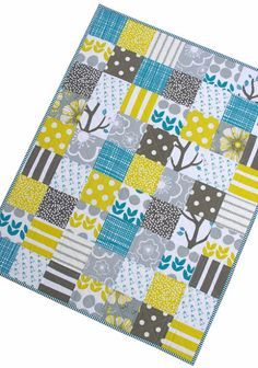 use charm packs sewn in rows like this and then in between use strips of a solid that coordinates?