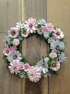 This serene hand painted pine cone wreath is unique and will blend in well with your modern decor. Soft pinks, blues and grays are charming and exquisite. * 13.5 x 13.5 * Sprayed with clear acrylic coat * Hand painted * Wired Each pine cone is wired for durability and hand painted for