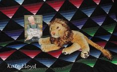 My lion wants to use my giveaway quilt and read Sarting from Scratch! Enter contest on my website.
