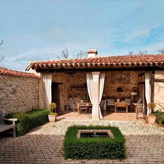 Run away to the dreamy country house located in Spain. This adorable rustic country house that used to be a rural school once is designed by Mikel Larrinaga. Outdoor Curtains, Outdoor Rooms, Outdoor Living, Indoor Outdoor, Spanish Style Homes, Spanish House, Spanish Bungalow, Style Hacienda, Stone Facade