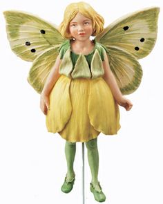 The Buttercup Flower Fairy, the charm of Cicely Mary Barker's Flower Fairies has been brought to life in these precious figurines. Display them with the gold cord or use the 6 inch wire pick provided to decorate flower arrangements, plants or gift baskets.