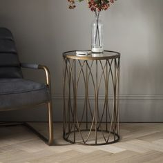 Hillgate Side Table  A stylish and practical side table with an antiqued glass top in a bronze effect finish.
