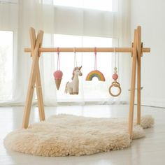 Unicorn Wood Baby Play Gym Frame with 4 Mobiles by LanaCroch. Making Wooden Toys, Handmade Wooden Toys, Wooden Baby Toys, Wooden Diy, Baby Furniture, Handmade Furniture, Homemade Baby Toys, Mobiles, Rainbow Ice Cream
