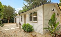 This is a 480 square foot tiny cottage in Los Angeles for sale. The property also features a separate garage/storage building. Inside, you'll find one bedroom, one bathroom, a full kitchen, a…