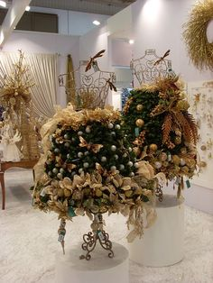 What a neat way to decorate a showroom for Christmas. We sell wire dress forms at MannequinMadness.com so you can re-create this