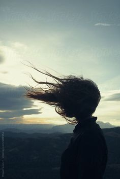 Girl's silhouette with her long hair blowing in the wind by Miquel Llonch - Stocksy United Sous Le Vent, Le Vent Se Leve, Blowin' In The Wind, Hair In The Wind, Girl Silhouette, Silhouette Drawings, Windy Day, Charles Bukowski, Pics Art