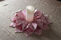 Beautiful, handmade Valentines table wreath. This Valentines wreath is made from cotton, and on the inside of the two pieces of cotton, there is interfacing to help the wreath stand up. Each square is top stitched to add more strength.  A brand new candle does come with the wreath. The candle can change colors and has the flicker like a real candle. All material pre washed. Comes from a smoke free home. We recommend when storing your wreath to put newspaper or tissue paper inside the wreath…