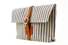 This style would make a good IPAD bag. The Clutch in Blue and White striped ticking. $48.00, via Etsy.