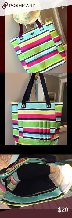 Thirty One Tote Preppy Pop Thirty One tote in the Preppy Pop pattern. Zip top (open on sides), one zippered pocket inside, pouches for carrying items on one side of bag. See photos. Easy to clean polyester material. Like new inside and out. Perfect for upcoming trips to the beach or grocery shopping or whatever! Thirty One Bags Totes