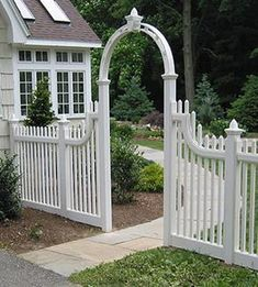 White picket fence --- like the narrow arch. It'll keep it from getting too shaggy