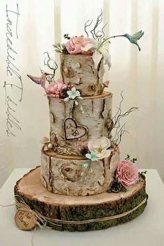 Rustic country wedding....wood slices cake with flowers