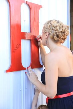 Such a cute idea! Have your guests sign the letter of your last name instead of a guest book!