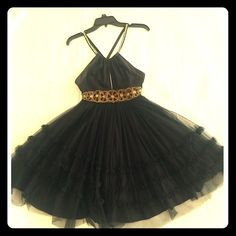 Free People Cocktail Dress Adorable black cocktail dress with layered tulle skirt. Adjustable straps cross in back. Jeweled waistband. I have gotten so many compliments on this unique dress! Free People Dresses