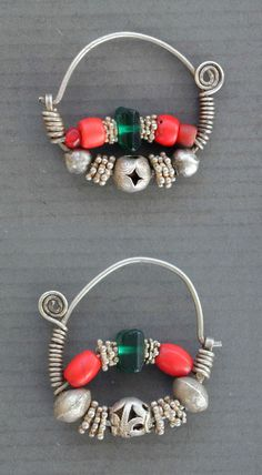 "Uzbekistan | Pair of antique silver, filigree and glass Uzbeks or Tajiks earrings.  Small silver granulés, and red and green glass beads ( including one small cornaline d'Aleppo ). Very good alloy of silver. | See similar sample in "" Jewellery from the Orient - Treasures from the Bir Collection "", by Wolf-Dieter Seiwert, p. 192 and in "" Uzbekistan "" by Johannes Kalter and Margareta Pavaloi, p. 298.  